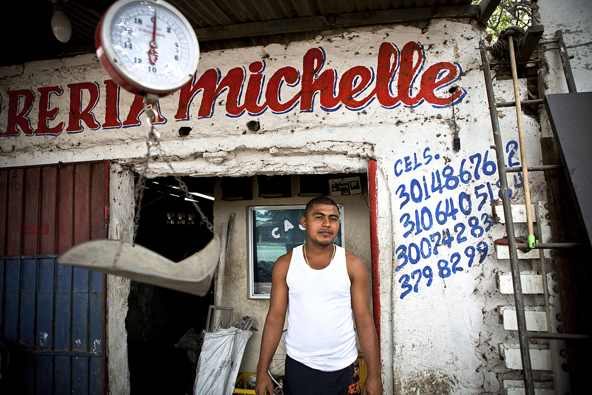 Jimmie owns a business where the local recyclers weigh and sell materials. Barranquilla, Colombia 2014