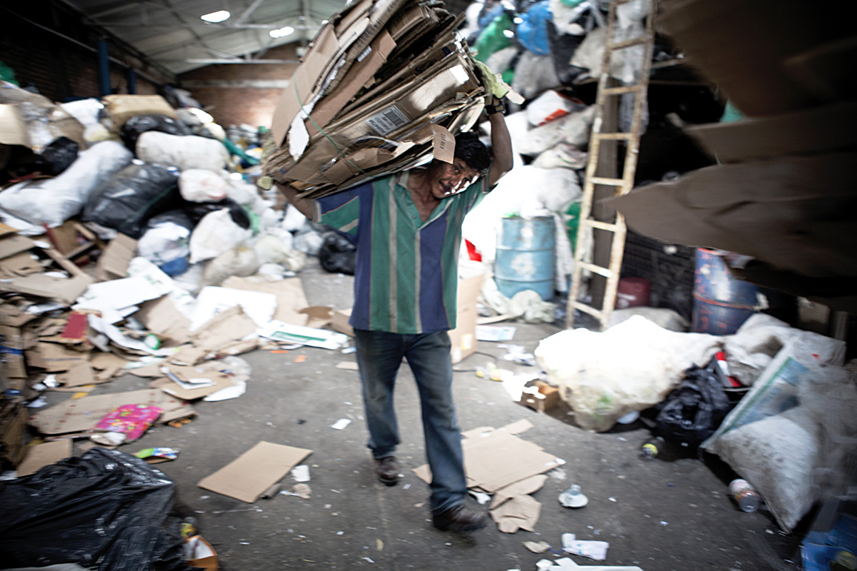 Man recycling cardboard at ARB.  Bogota 2014.