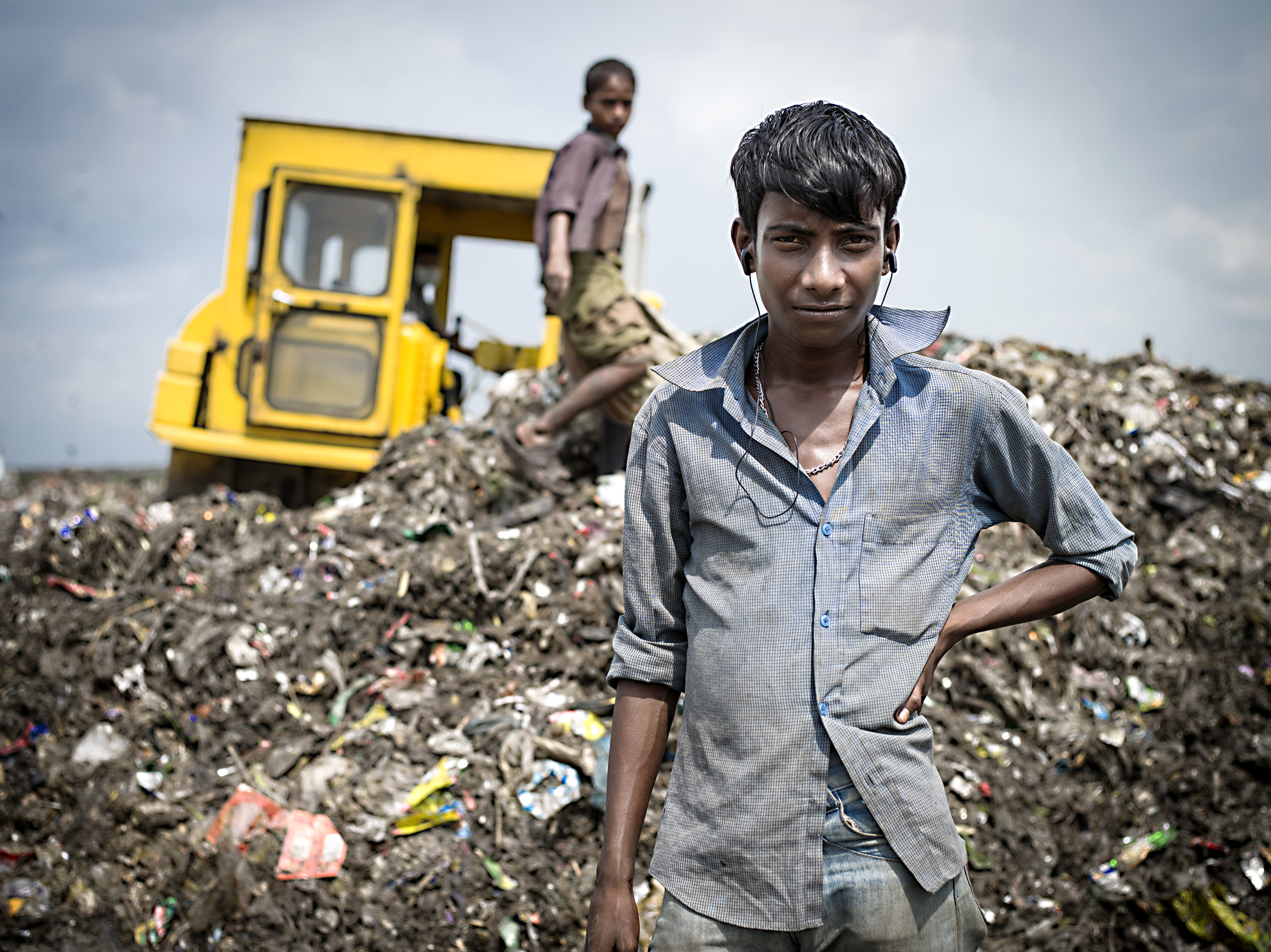 A boy sorting through trash at Aminbazar Sanitary Landfill, Dhaka.