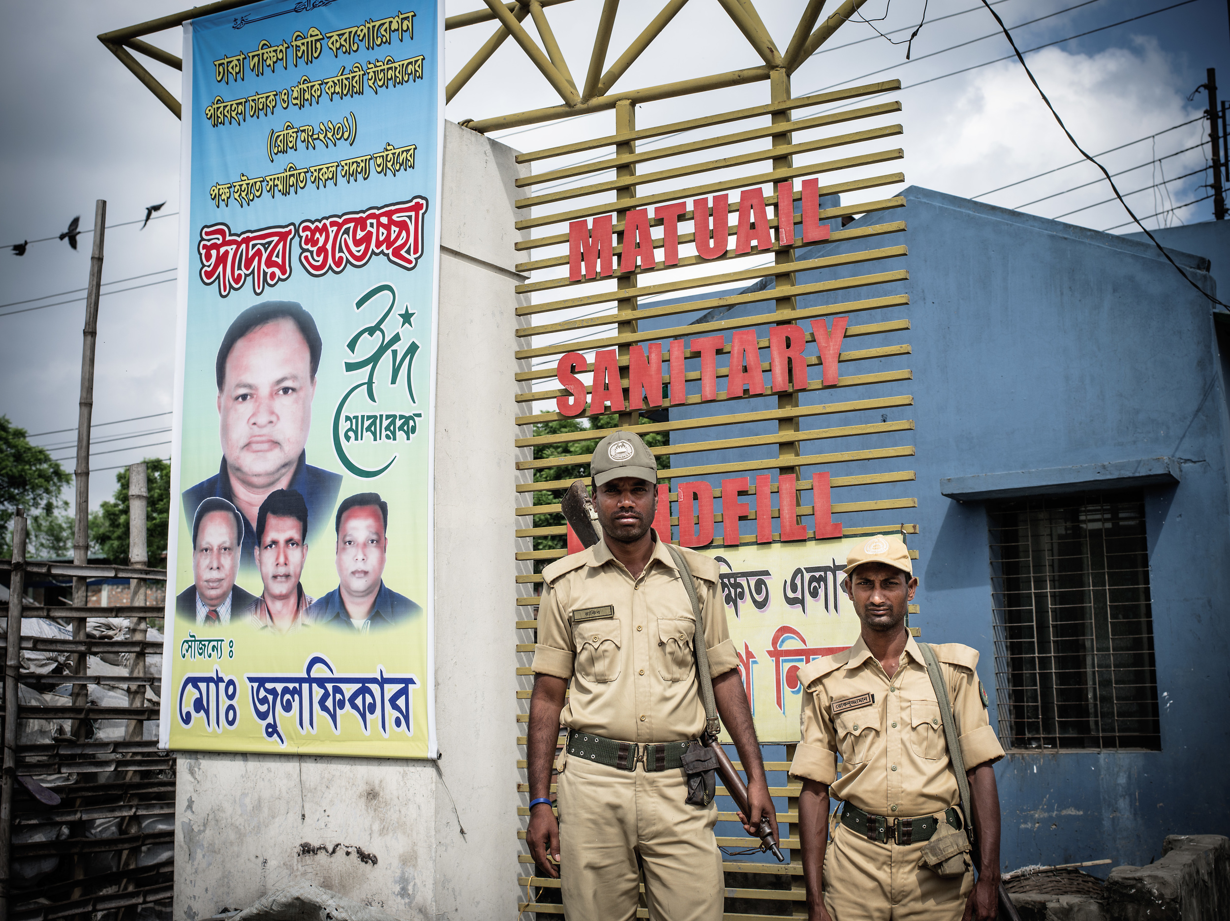 Guards at Matuail Landfill in Dhaka, Bangladesh.