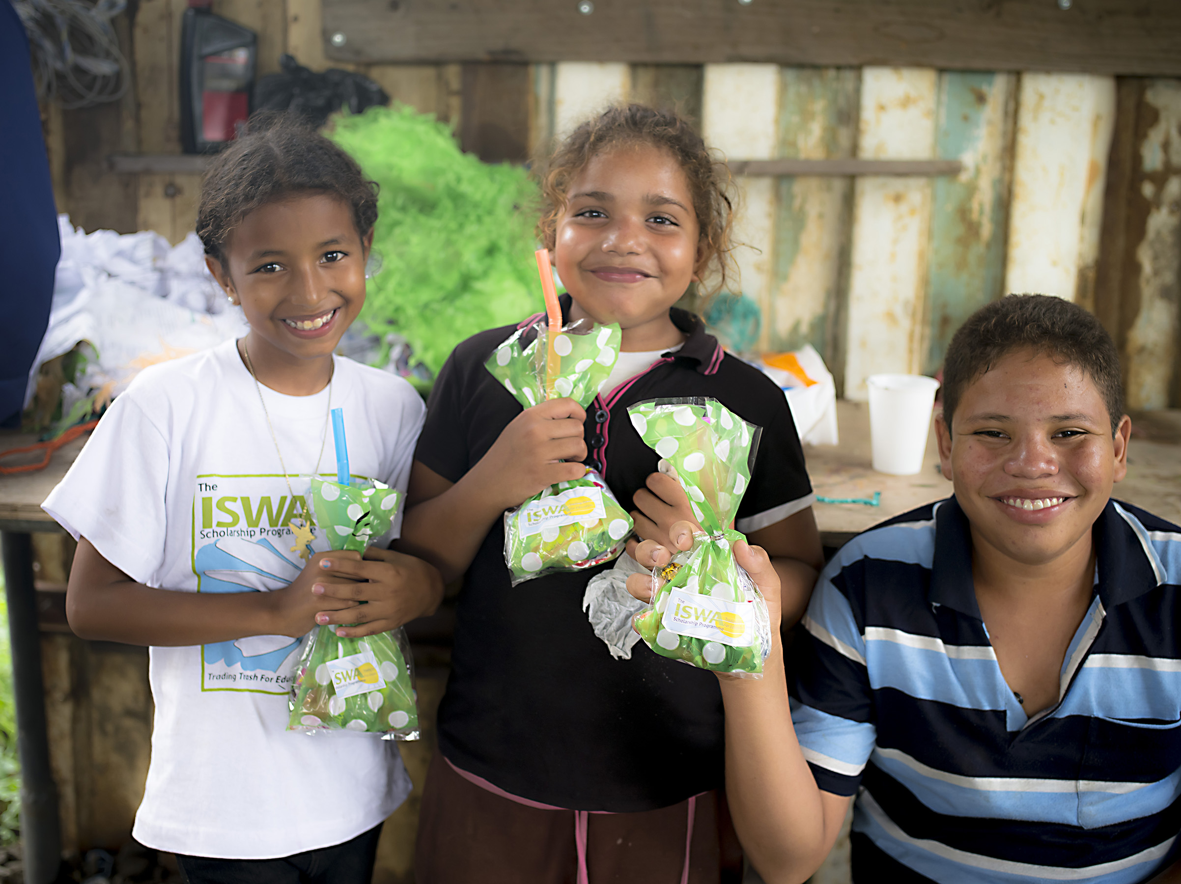 Genesis, Esteysi and Cesar show their ISWA gift bags.