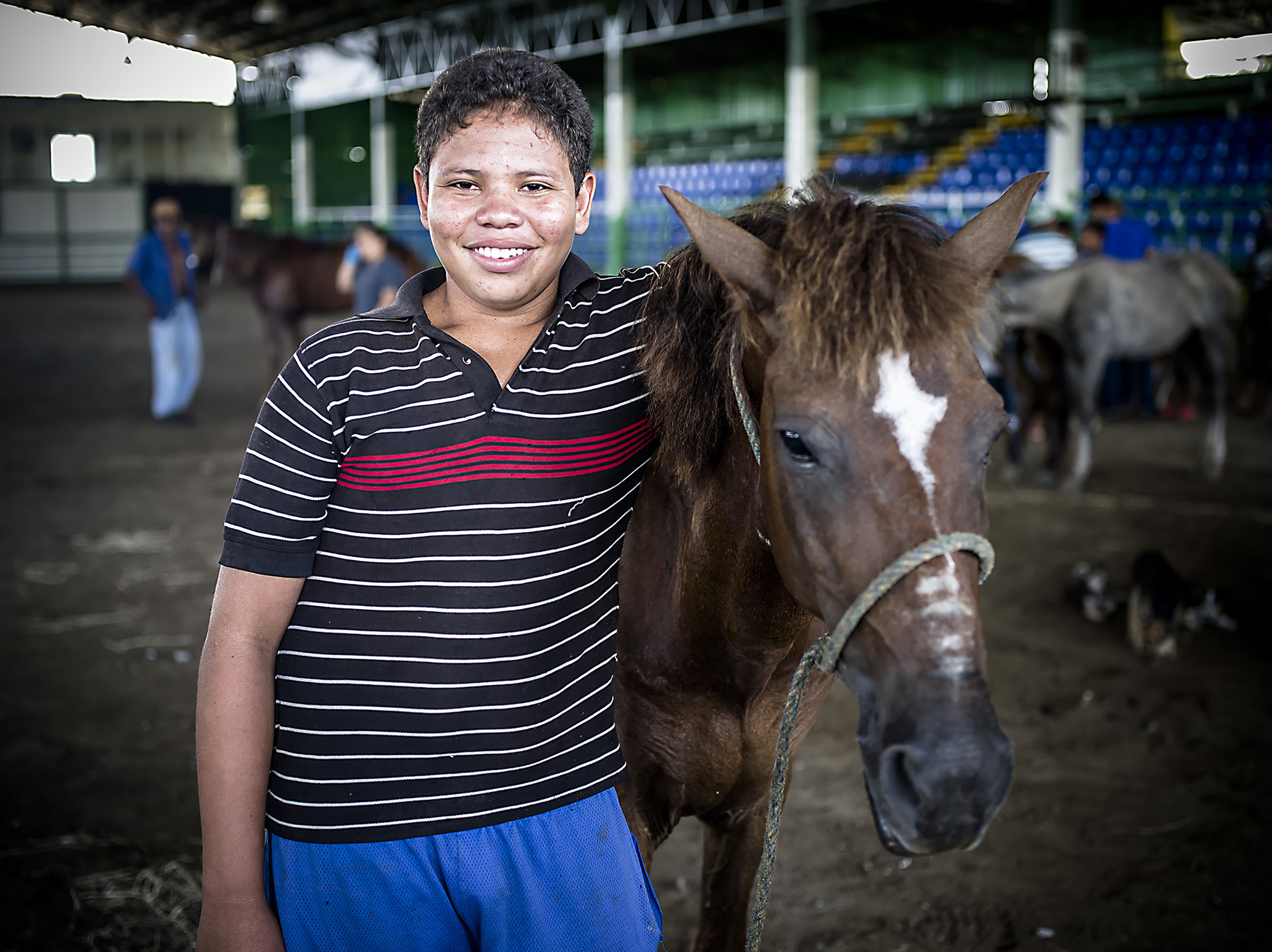 Cesar from the ISWA Scholarship Programme shows off his family's horse.