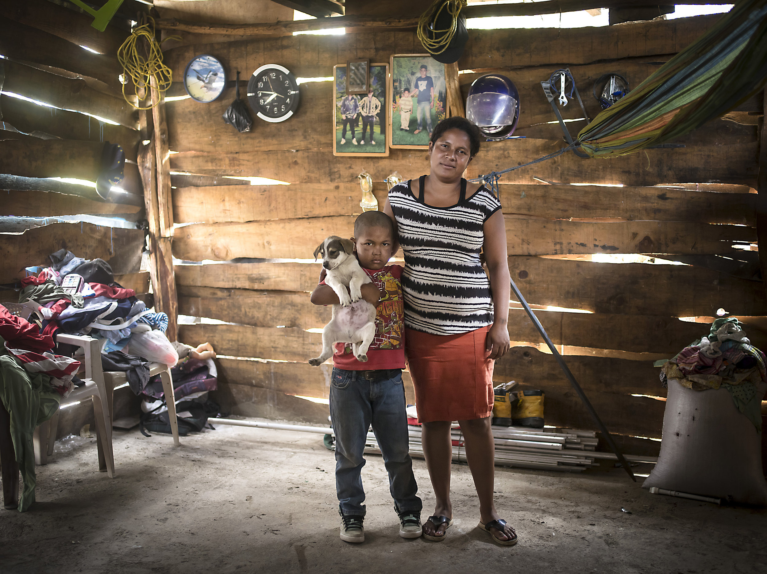 Elizabeth and her son together in their home outside the Esteli dump where they both informally sort garbage.