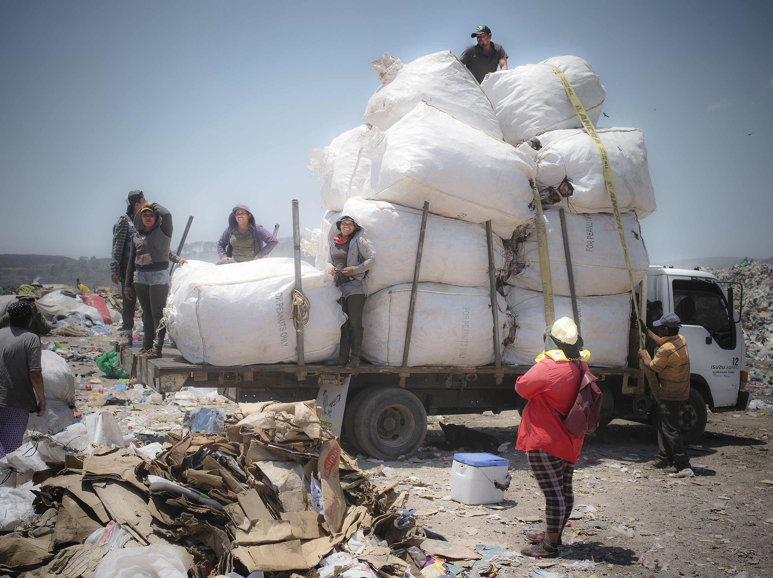 This group works for the Mara Salvatrucha and this bundle had reached it's max. The gang hangs out inside a large room with couches and scales. They do not recycle, they only wait to buy the materials as it's collected around them.