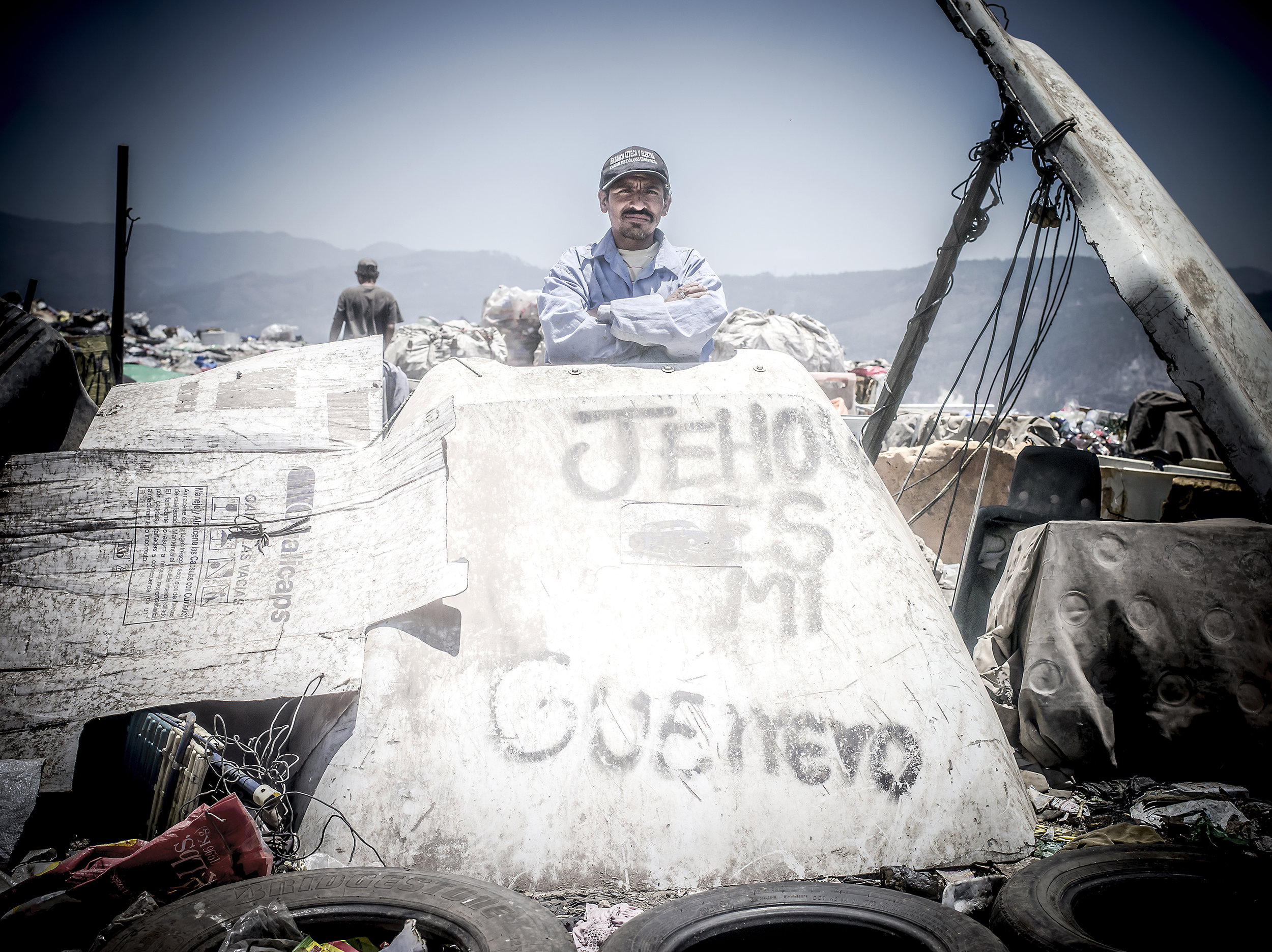 """Man proudly stands in front of graffiti that reads, """"Jesus is my warrior."""""""