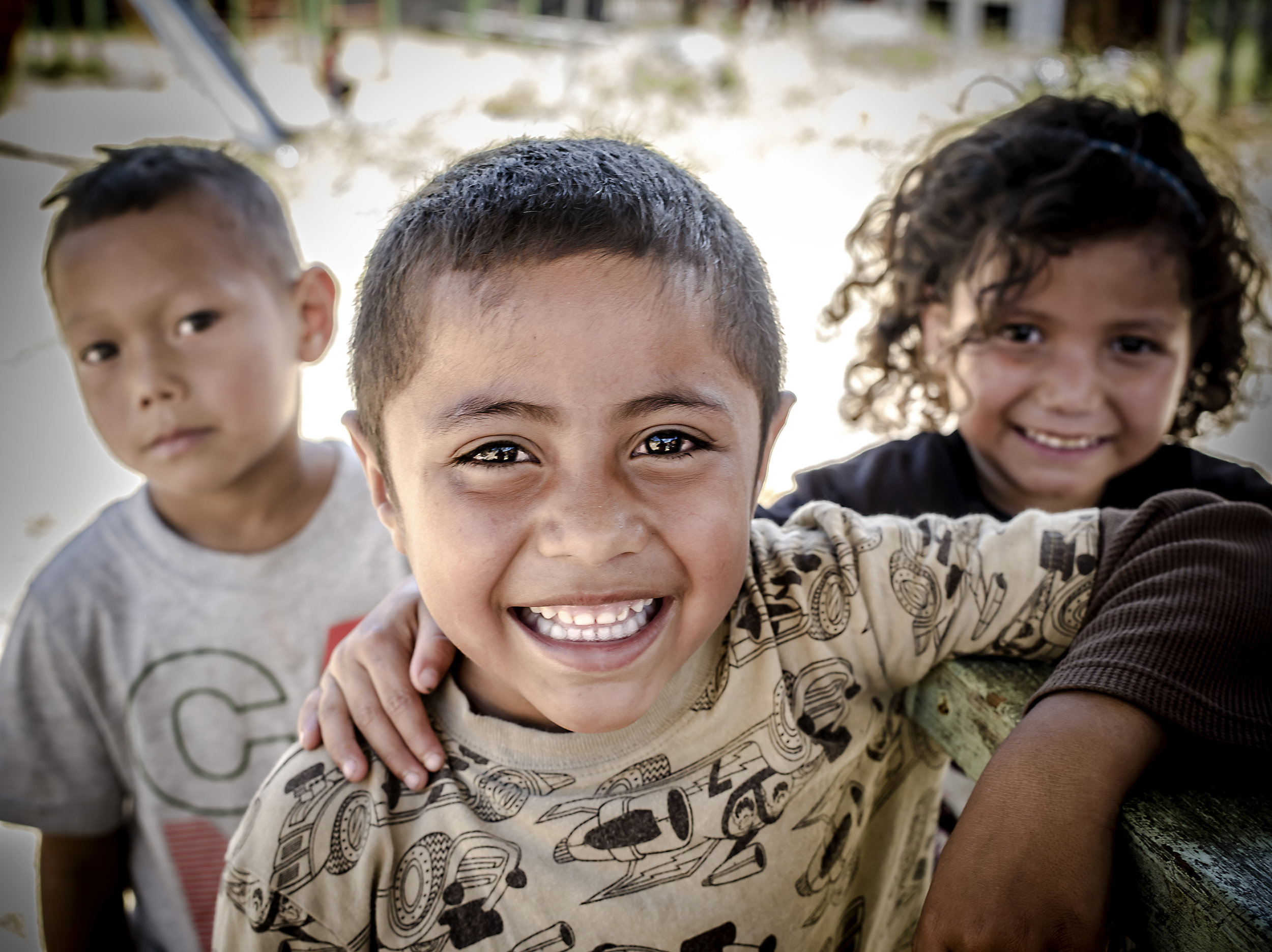 Carlito and friends who were from the dump, but now are in primary school.