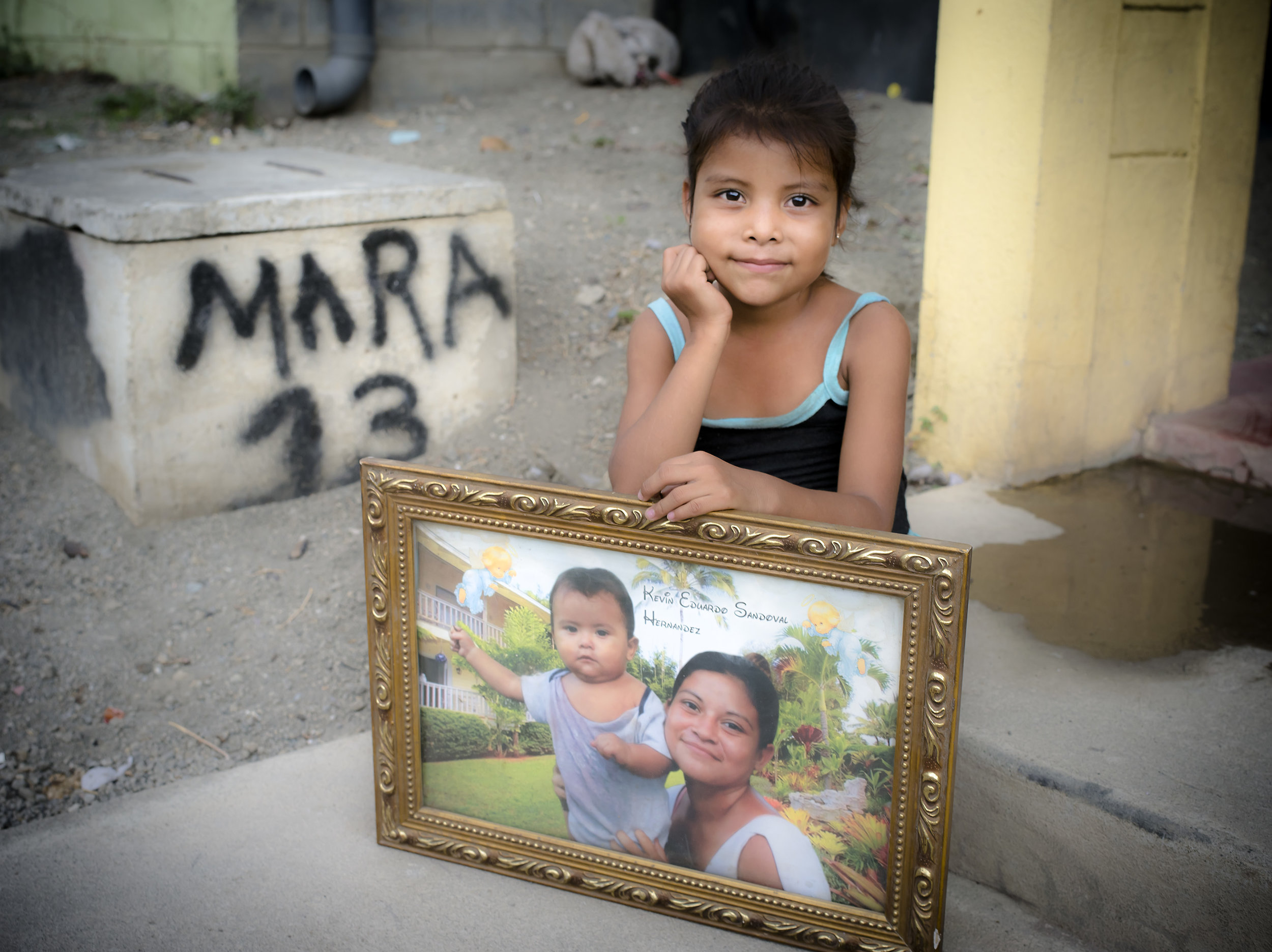 Cynthia sits in front of her home in Villa Guadalupe.