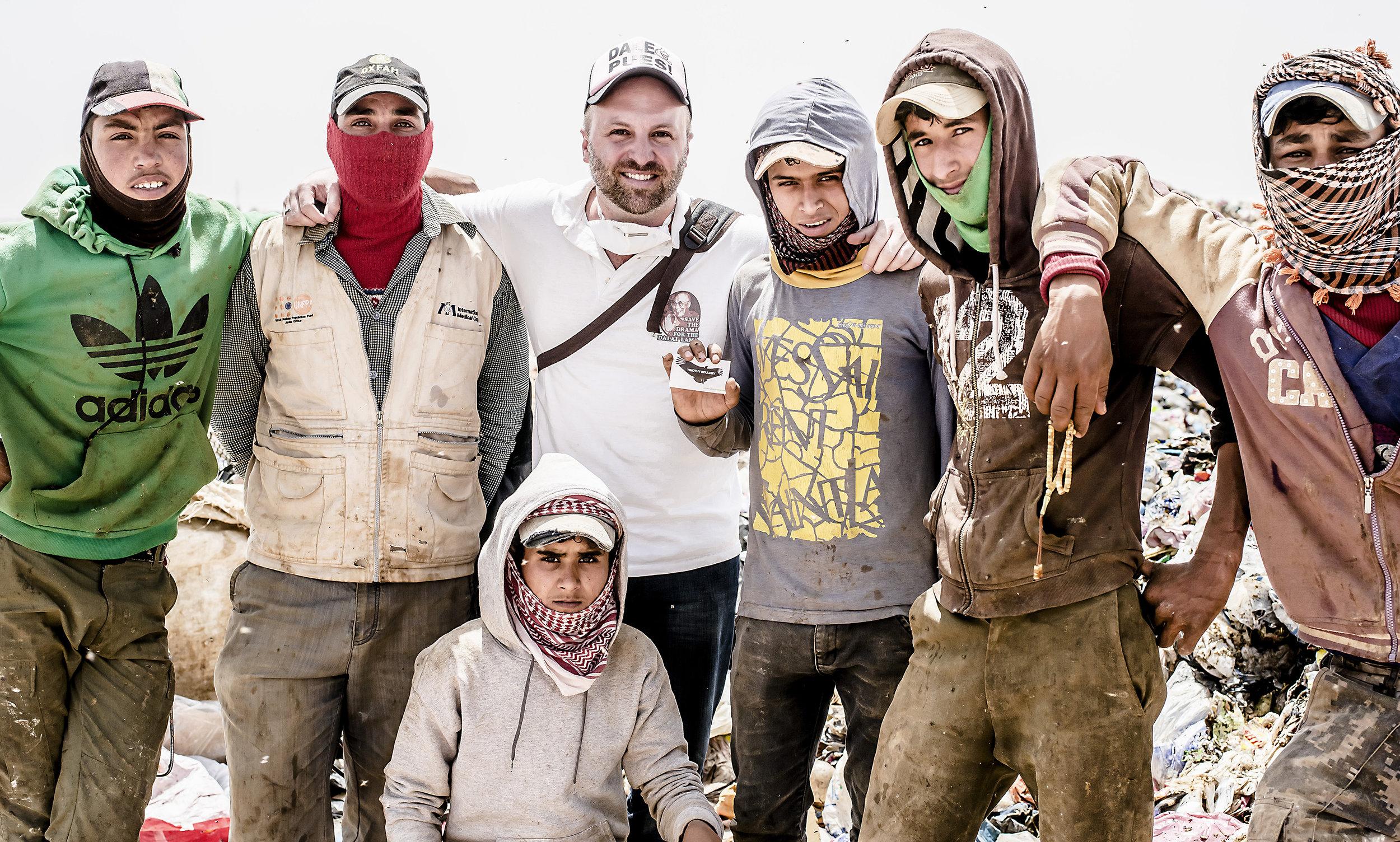 Timothy Bouldry with Syrians working at the Huseyneya dumpsite in Mafraq, Jordon.