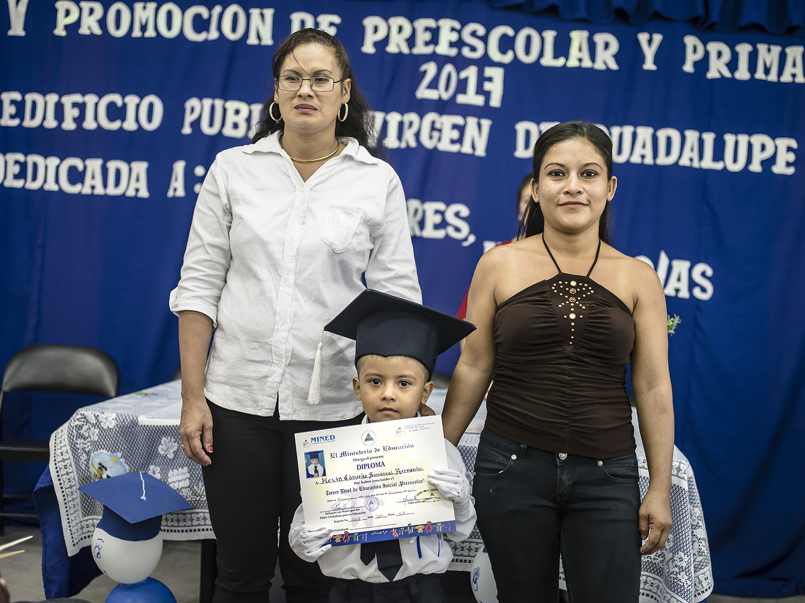 Marjorie and her son Kevin receive his diploma for preschool.