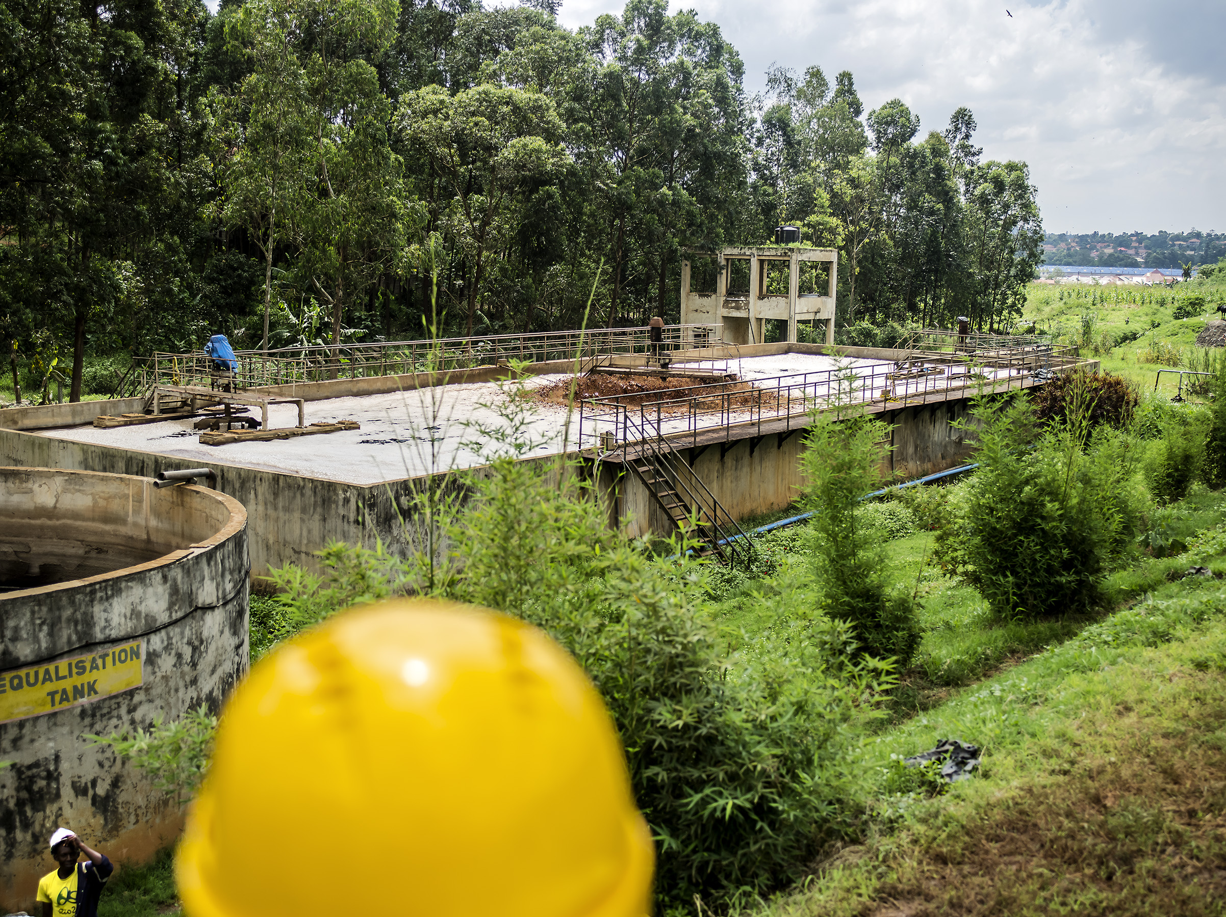 Leachate is directed into an equalization tank and also a an aeration tank. The final stage to cleaning the water is not operating now, but eventually the water will be clean enough that in can return back to nature. Kampala.