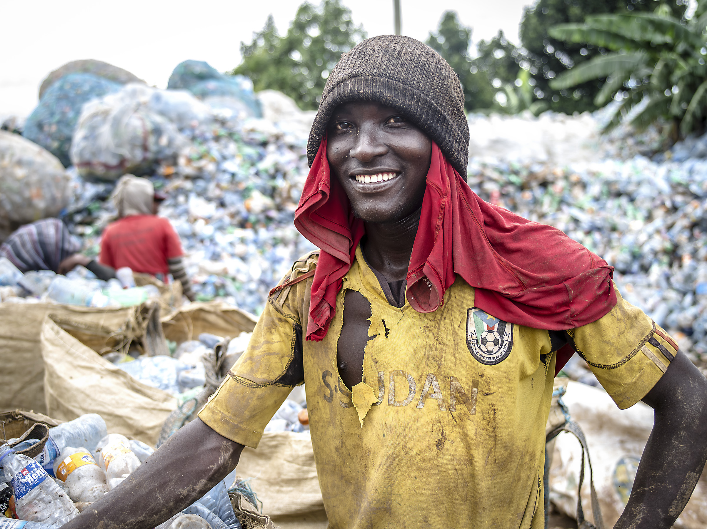 Man sorting plastics at the Kampala dumpsite.