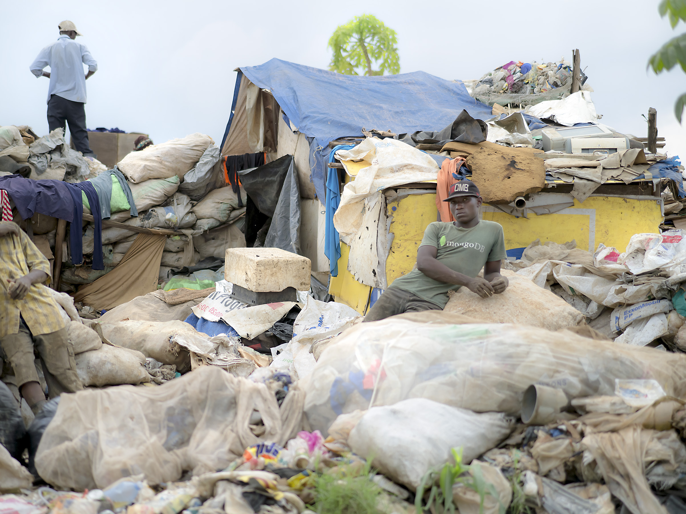 Men at their self-made work and resting stations on the side of Kampala dumpsite.