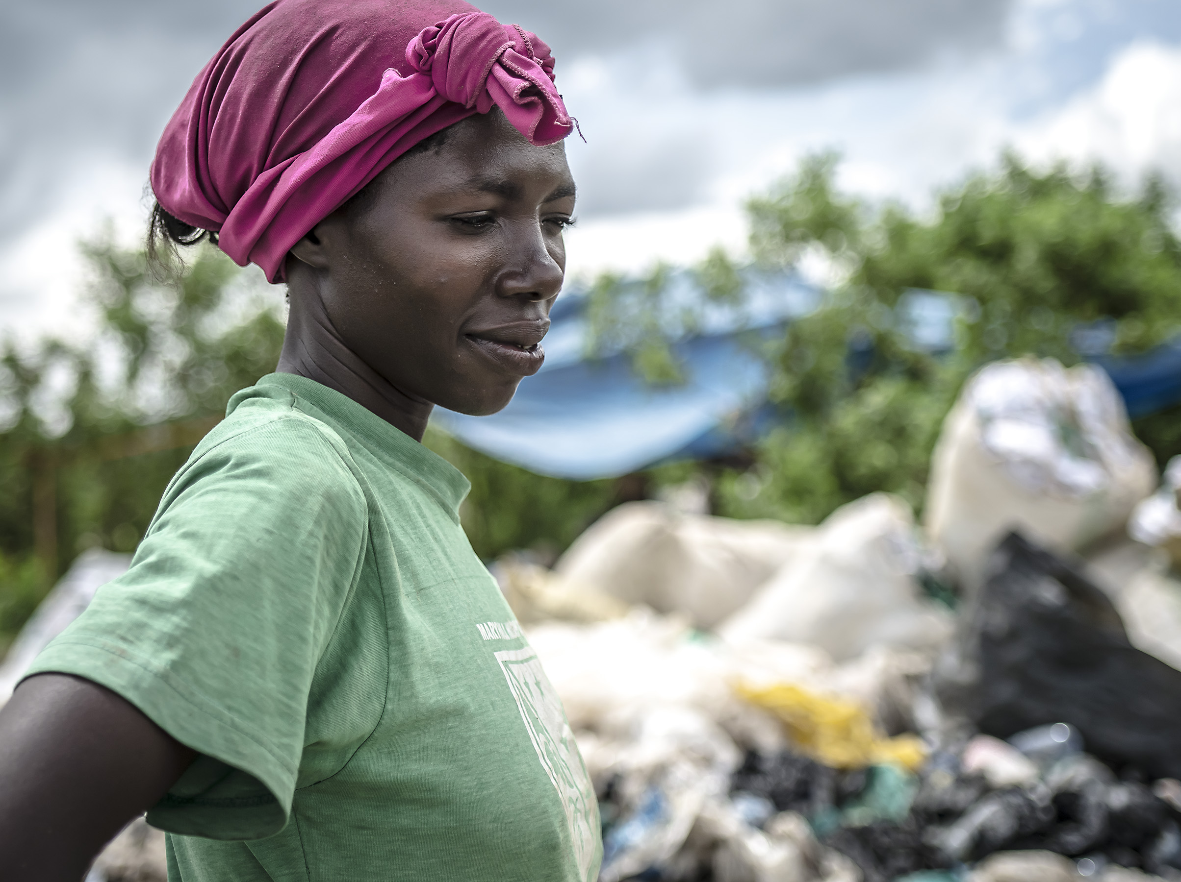 Woman recycling at the Masaka dumpsite.
