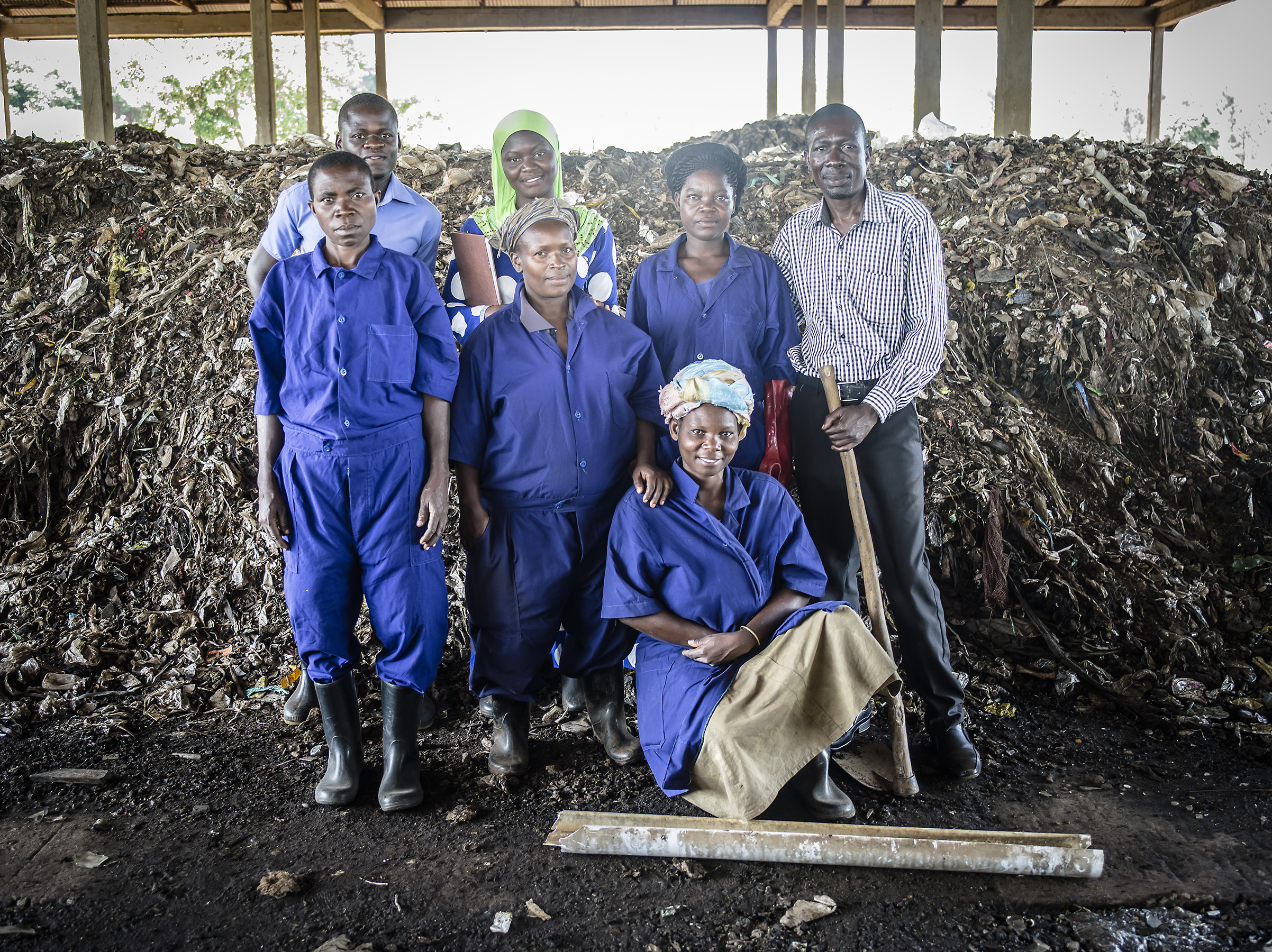 Contractors and workers pose together from the Jinja dumpsite.