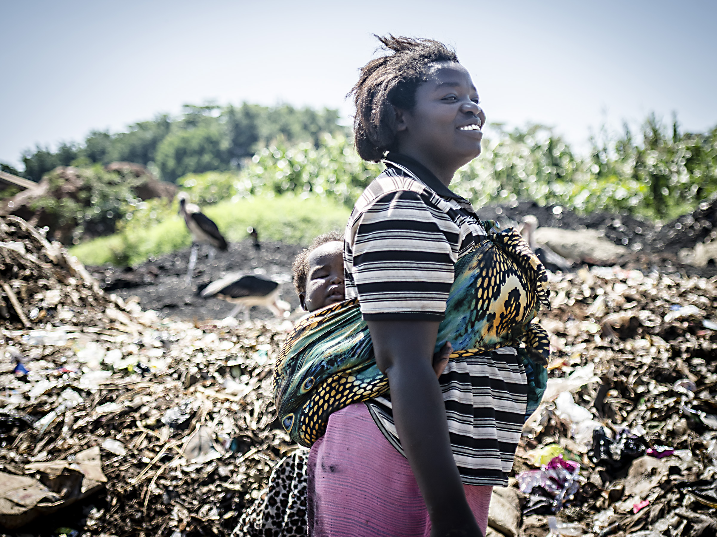 Woman and child working in the Jinja dumpsite.