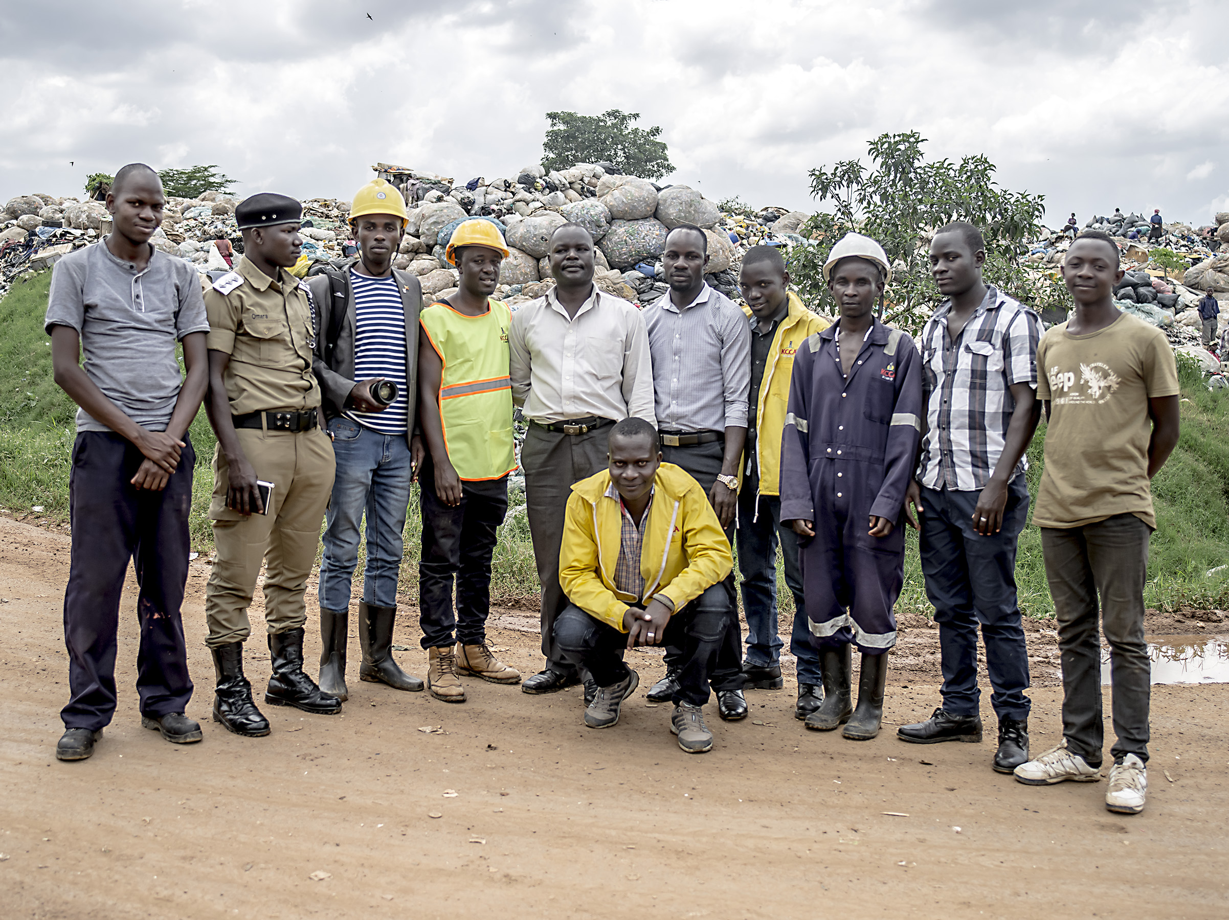 Taremwa Sam Rwabwehare with everyone who helped in Kampala dumpsite.