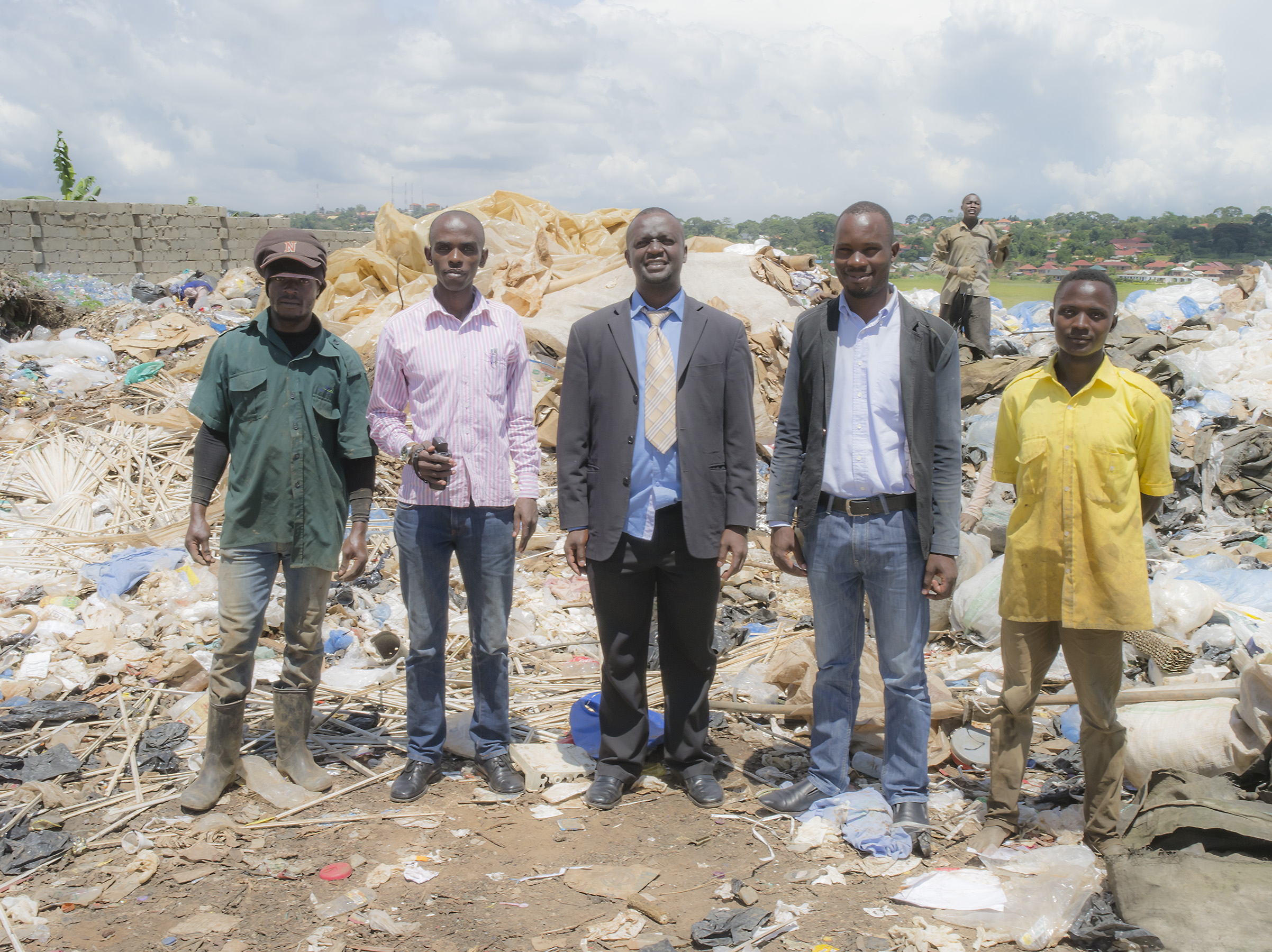 Environmental officer with informal workers from the Nkumba dumpsite.