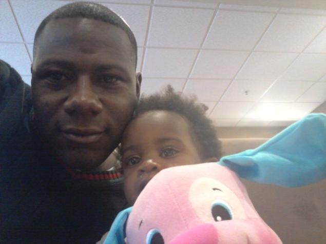 Sgt. Terry Achane of South Carolina, with his daughter Teleah, 22 months, after a court hearing in Utah 2013-01-25