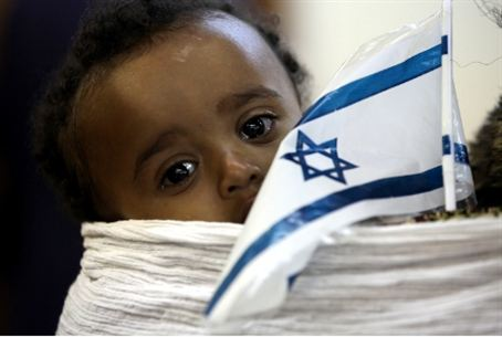 Ethiopian child with a Jewish/Israelite flag