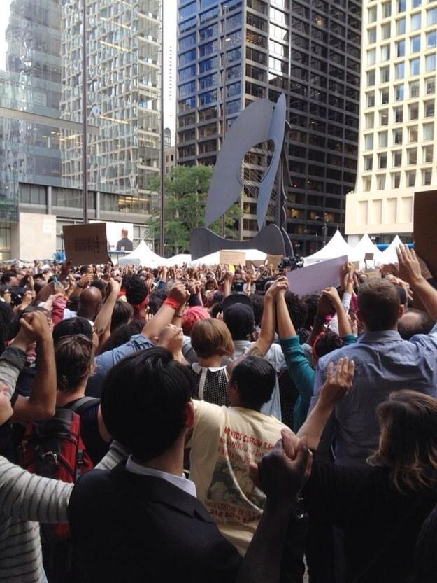 @plussone: #NMOS14 #Chicago People join hands during several minutes of silence at Daley Plaza. AP Photo/Erica Hunzinger  http://t.co/LFchMnWfCH