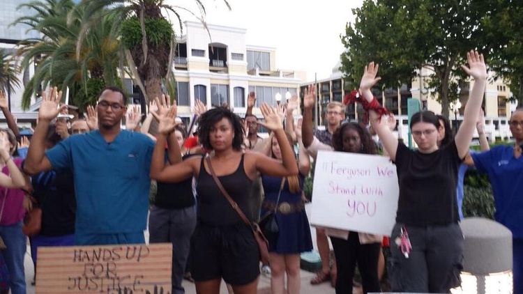 @vboey: Raising hands in solidarity at vigil for # MichaelBrown in Orlando. #FOX35 #NMOS14  http://t.co/cwK98mnk3w