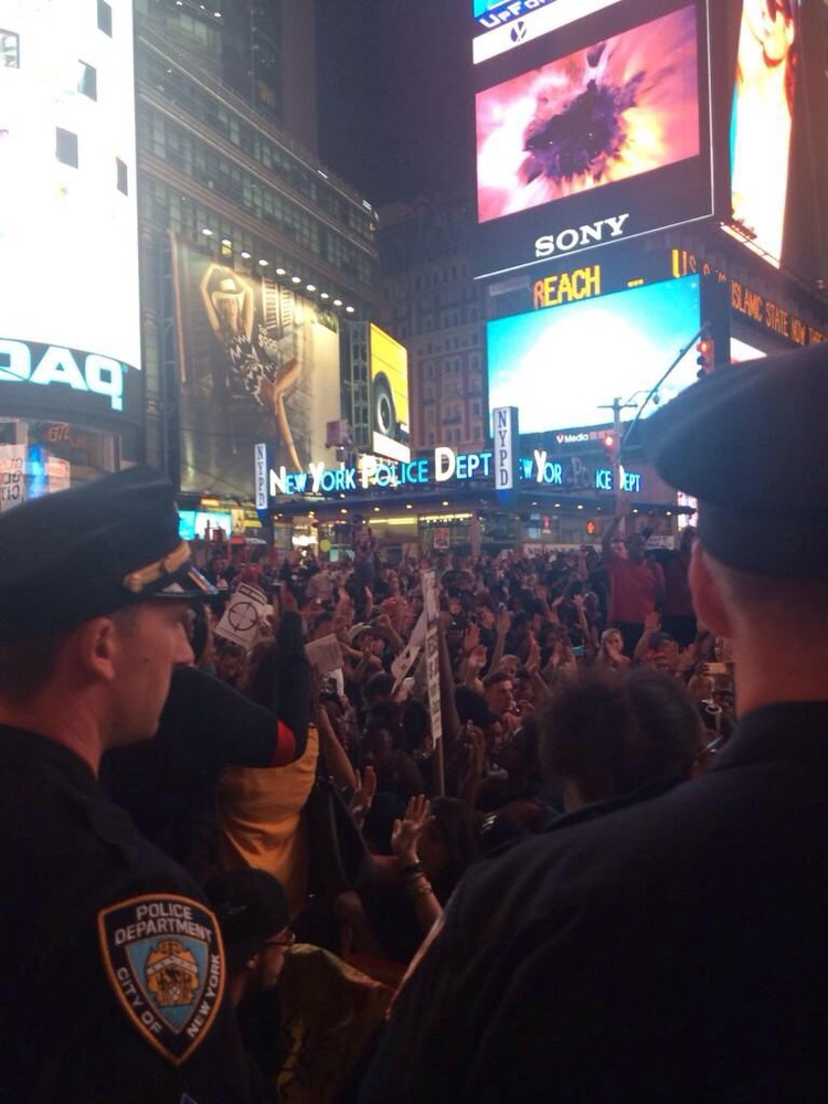 @samsanders: It's turned into a sit in in times sq #MichaelBrown  http://t.co/xHT3rxblxf