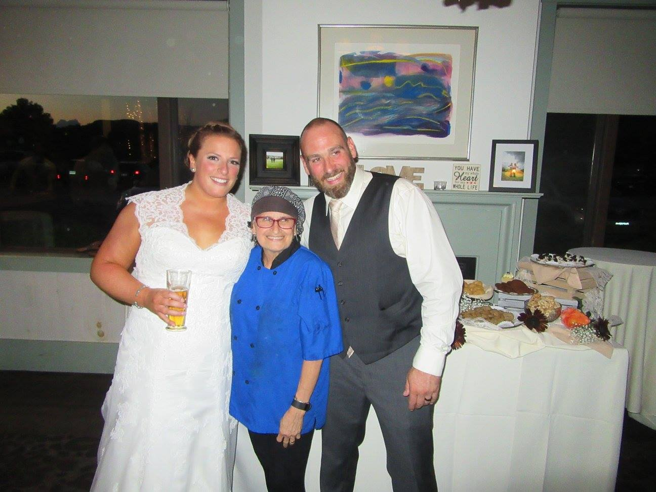 Chef Odille with the newlyweds and her famous Crissey Farm Petite Dessert Display.