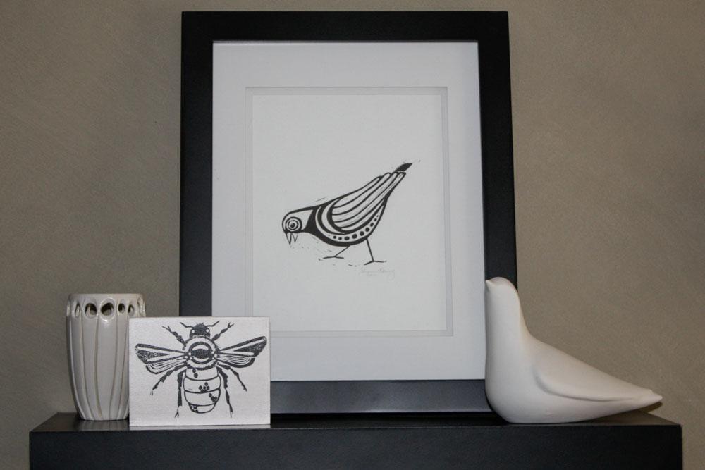 Bee Block Print: Sunny Mullarkey Studio, Bird Print: Sharon Lorenz, Ceramic Bird; West Elm, Carved Pottery Vase: Unknown