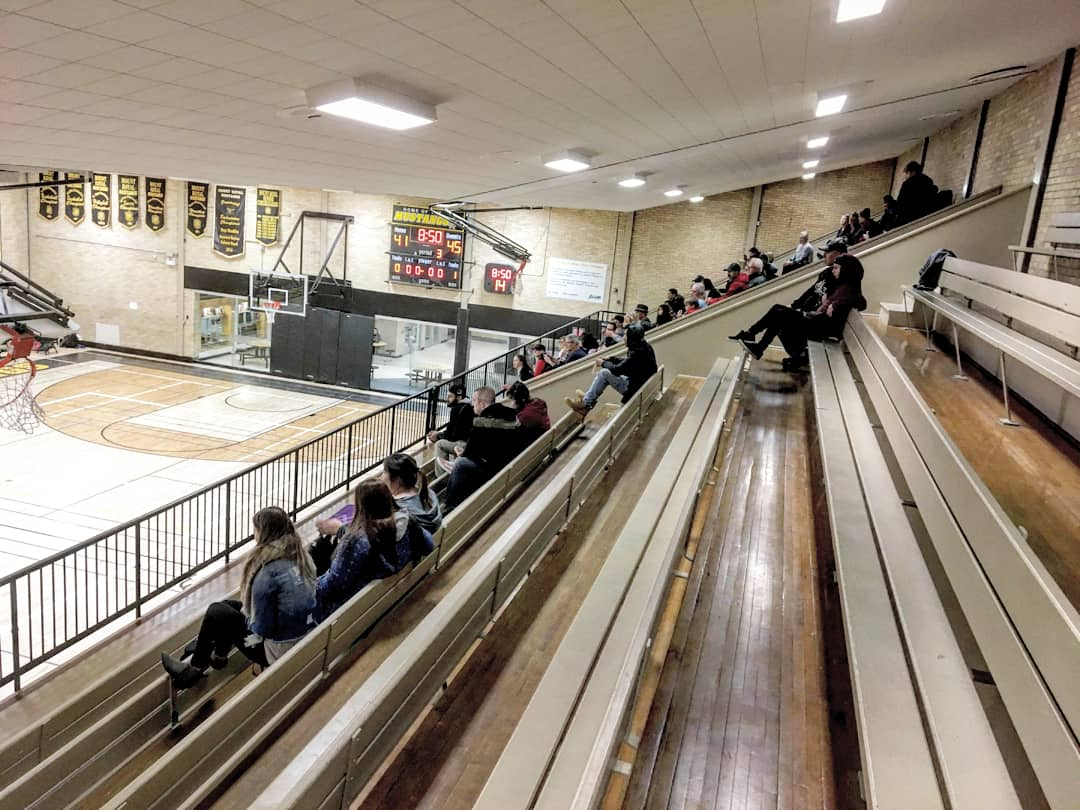 All the boys I know play on this side of the court.  This is a home game, and there's still no one cheering them on. The other side is completely full.