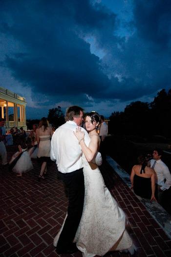 Wedding photograph by Denny Henry of bride dancing in Virginia