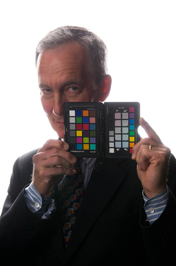 Portrait of Andy Grundberg with a colorchecker passport