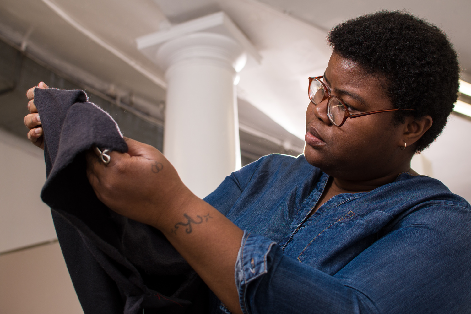 """Corcoran Student Khadijah Wilson works on her thesis project titled """"Object of Neglect Series"""" on April 3rd, 2017."""