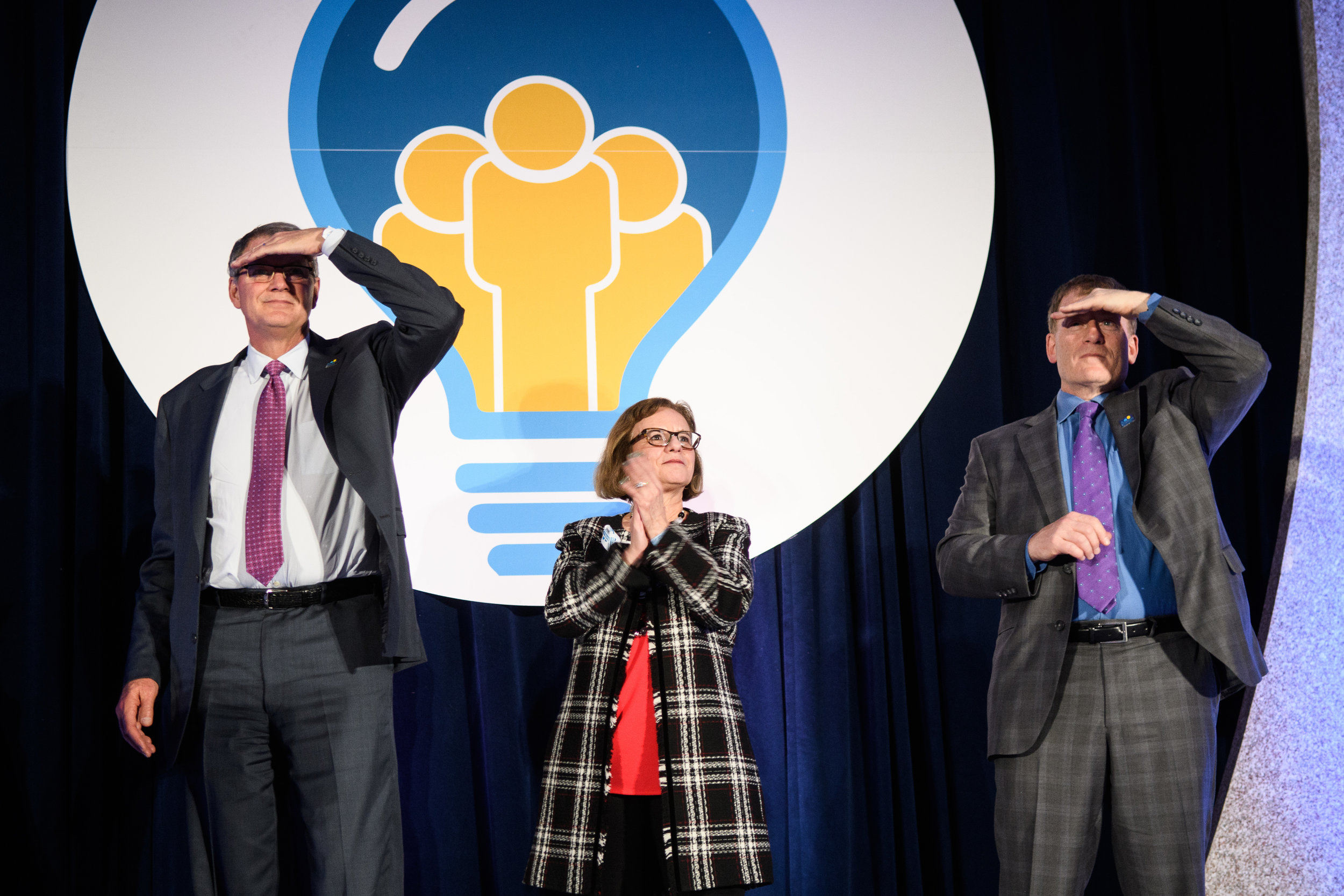 Photograph of conference speakers searching the audience. Washington, DC.