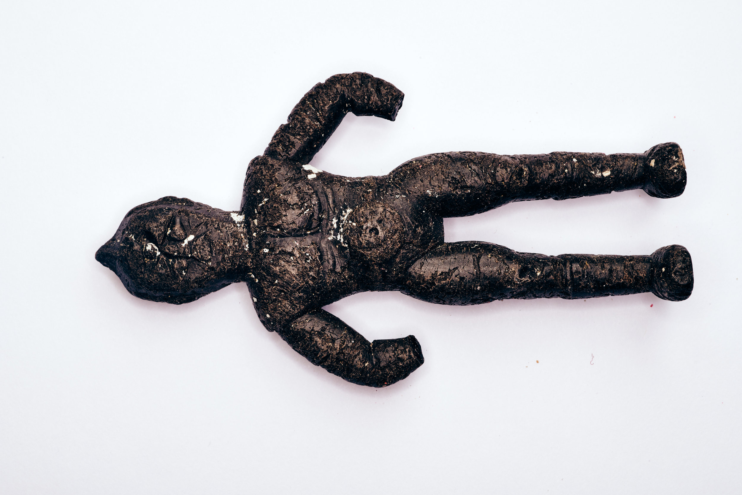 Photograph of a plastic action figure found in a sea bird.