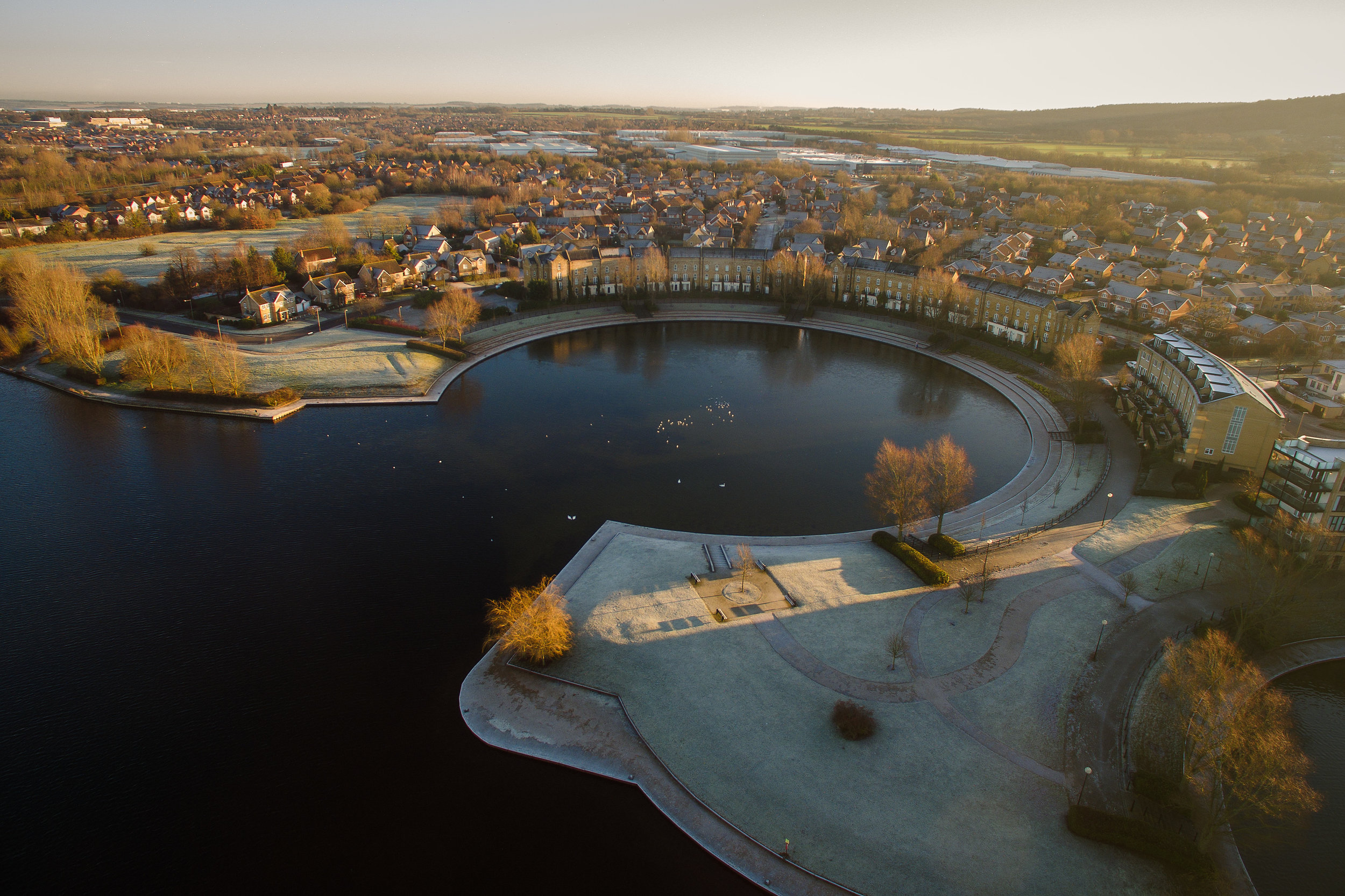 A frosty winter sunrise over Caldecotte Lake in Milton Keynes, photographed by Matthew Thompson using a DJI Inspire 1 drone.