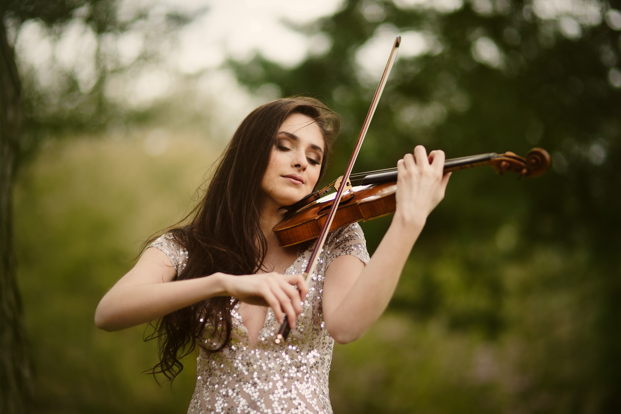 Esther Abrami playing her violin, with dress by Mishi May and makeup & hair by Kerstie Ann.