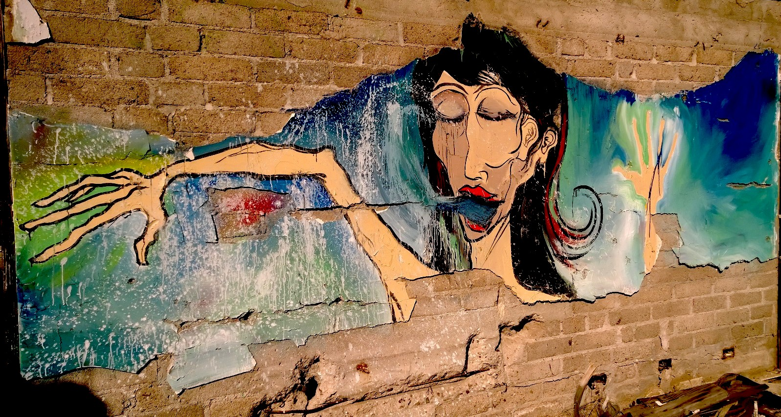 Abandoned House - mural lady in the sky.jpg
