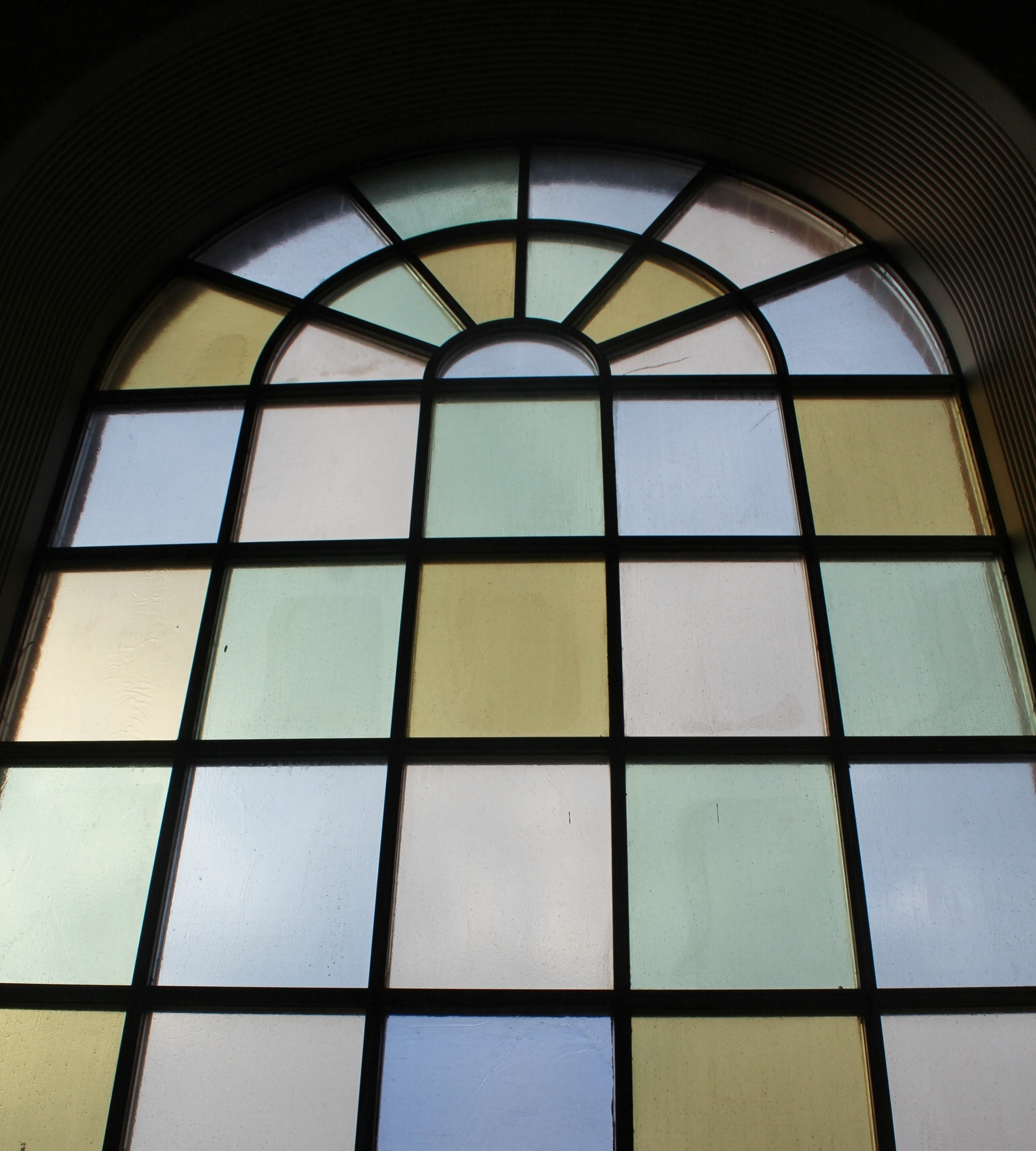 Calvary single stained glass with arch at top.jpg