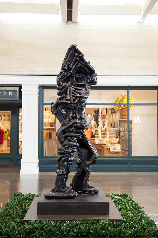 Thomas Housago  (British, born 1972) Yet to be titled (peeking figure) , 2012  Tuf-Cal, hemp, iron rebar, wood
