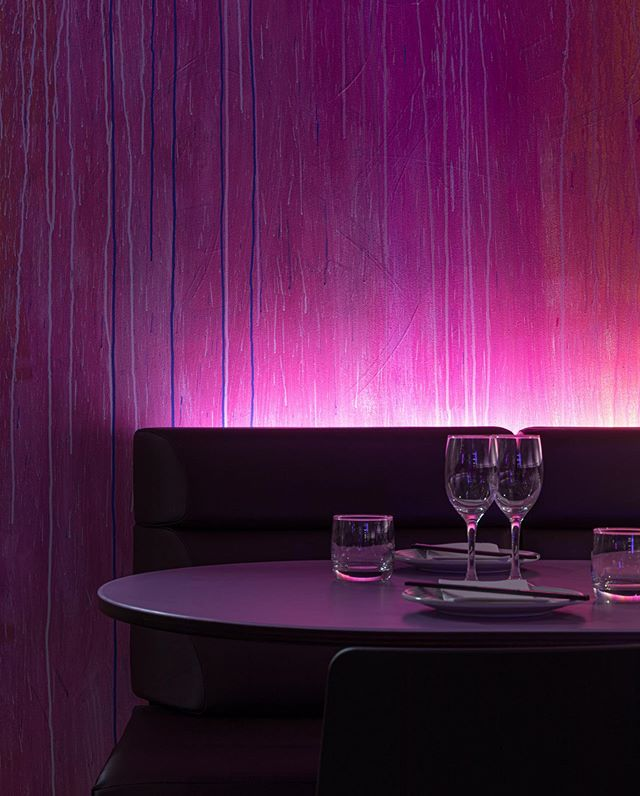 More Purple Rain. Old mechanics shop transformed into a Japanese eatery for the boys @sashjapanese.sydney . Dripping neon paint to the walls and a @fondationlecorbusier style banquette to get down and get (dirty). Glamours not our only thang...we can do industrial warehouse... Phot @rohanvenn . .wall by @shannoncrees . . #industrial #warehouse #neon #japanese #danflavin #lighting #purplerain #japanesefood #sydneyeats #sake #cocktails #bar #restaurant #interiordesign #restaurantdesign #grunge #surryhills #sydney