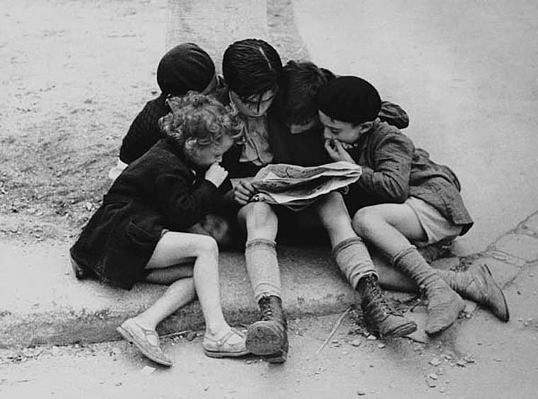 Untitled (Children Reading Newspaper, Paris), 1936  7.75 x 9.5 inches vintage silver print