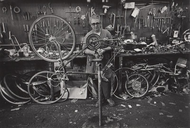 Untitled (Bike mechanic)   Vintage silver print  8 x 10 inches