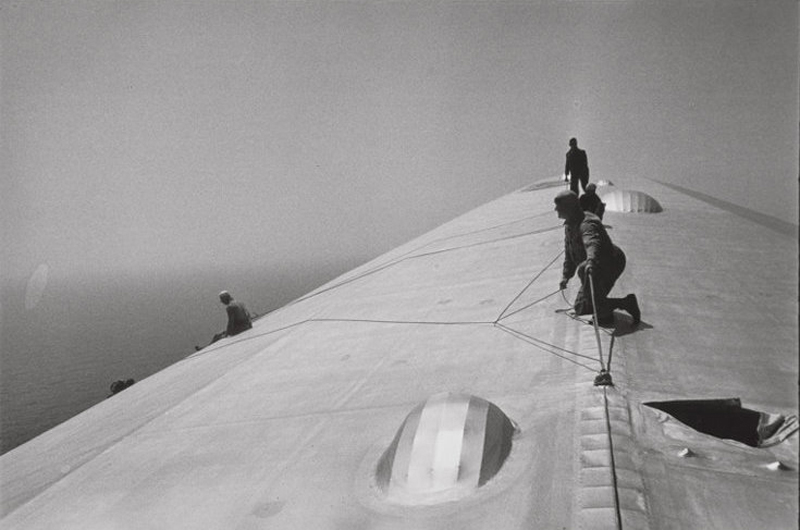 Alfred Eisenstaedt    Repairing the Hull of The Graf Zeppelin During the Flight Over the Atlantic , 1934  Silver print  20 x 24 inches  Edition of 250