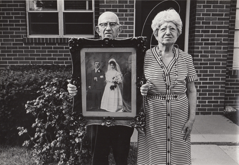 Untitled (Old couple with wedding portrait) , c. 1960's  Vintage silver print  8 x 10 inches