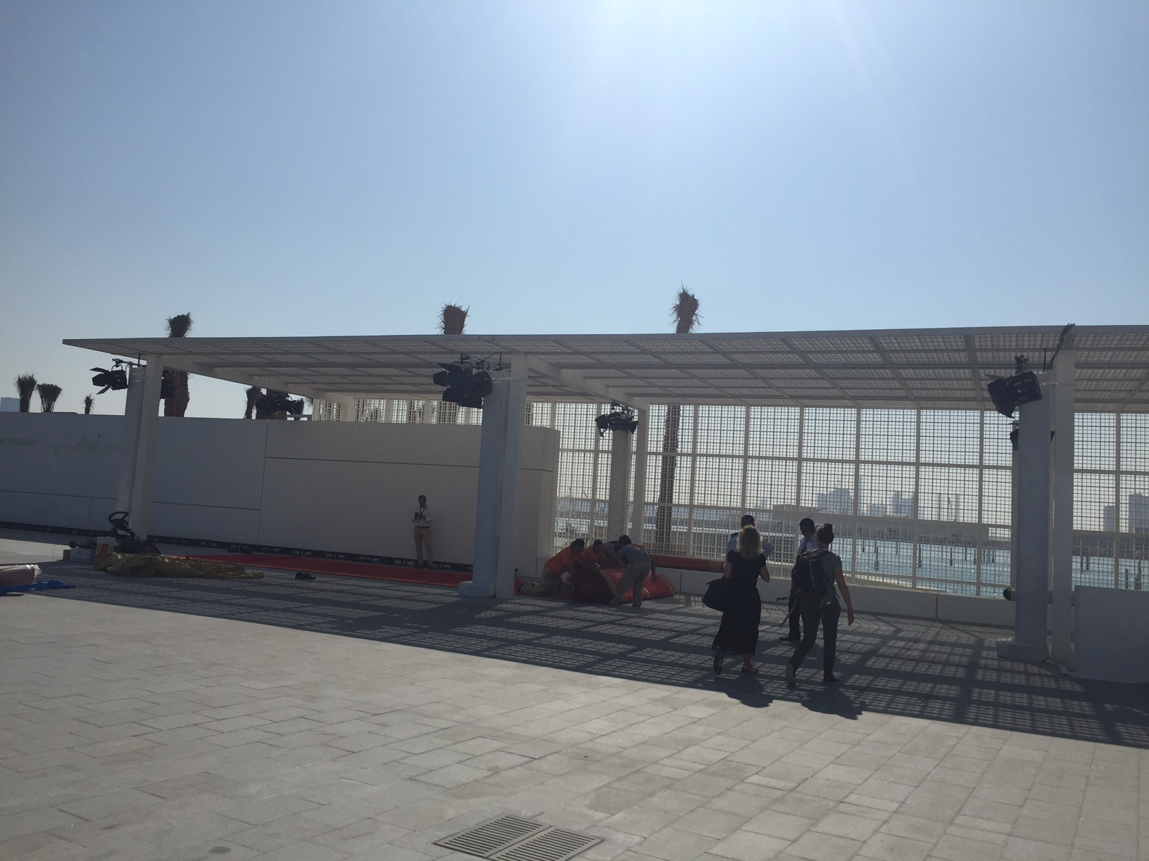 1.  Watching workers rolling out the red carpet on 6 November 2017, ahead of the Louvre Abu Dhabi opening events.