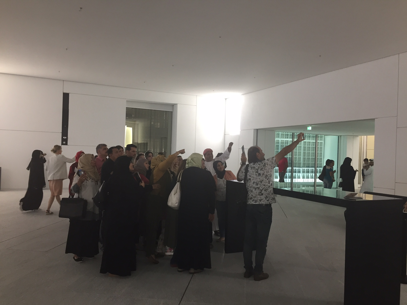 5.  Watching this group take a giggly selfie (no stick) in the lobby on 12 November 2017.