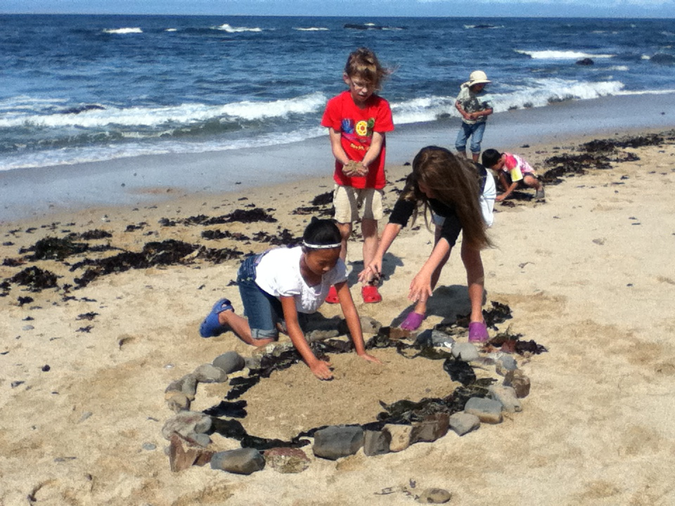 We all work together to design and construct sand castles
