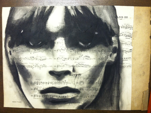 "Nico   Charcoal on antique sheet music, 9"" x 12"""