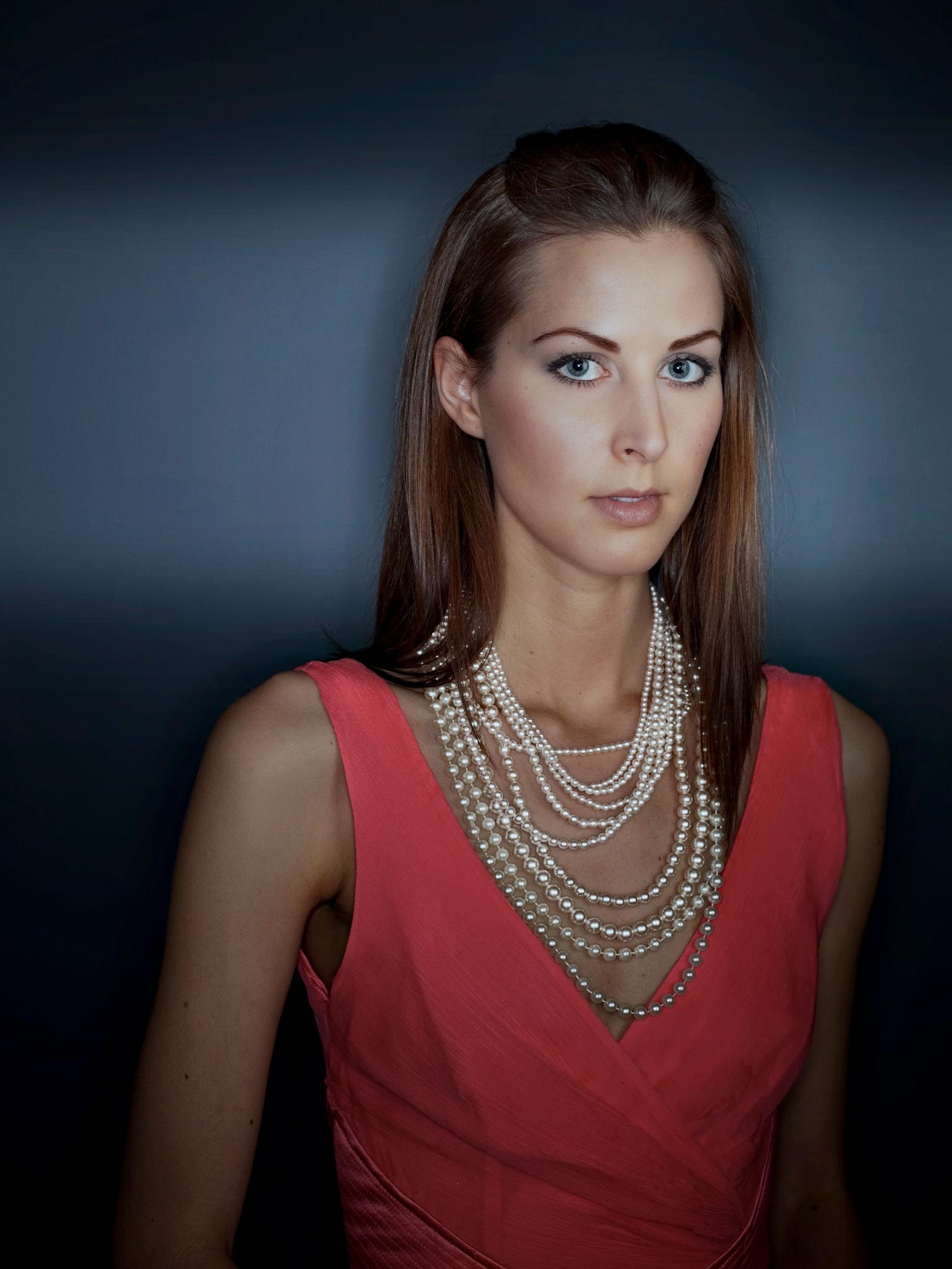 Jessica in dress w pearls.jpg