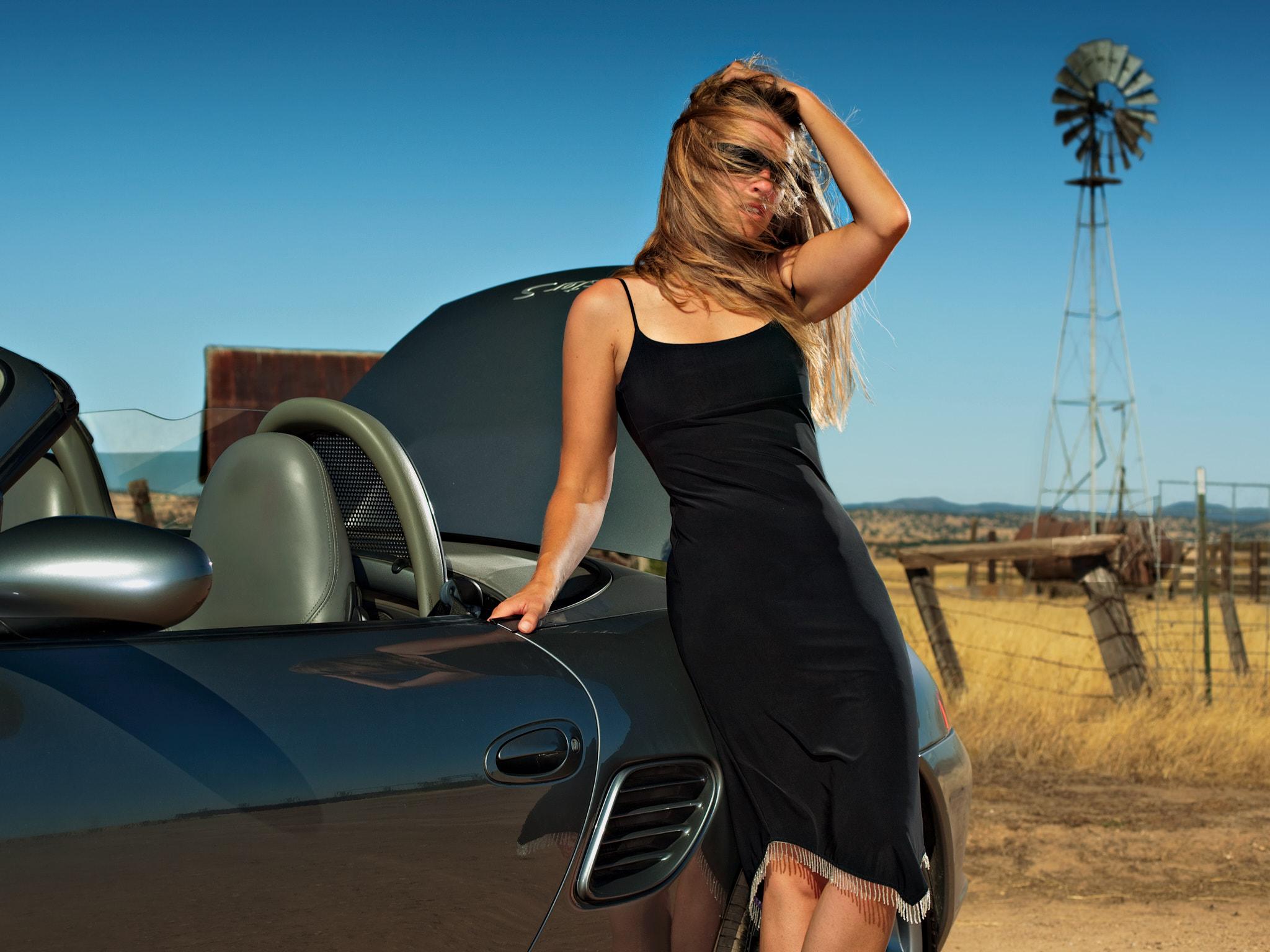 Melissa w Windmill and Porsche.jpg